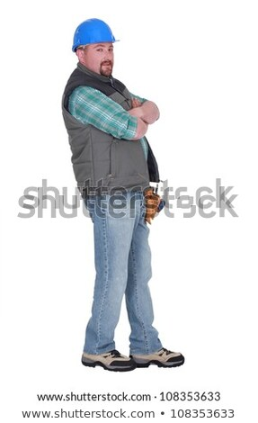 Stock photo: Stubborn builder with arms crossed