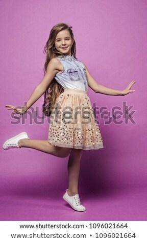 Aantrekkelijk jonge blond denim rok geïsoleerd Stockfoto © acidgrey
