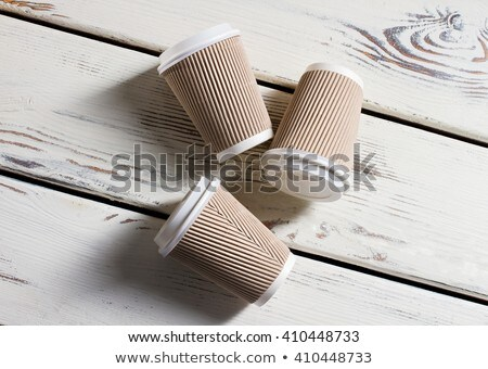 Hot cappuccino cup  run out on wooden table Stock photo © nalinratphi