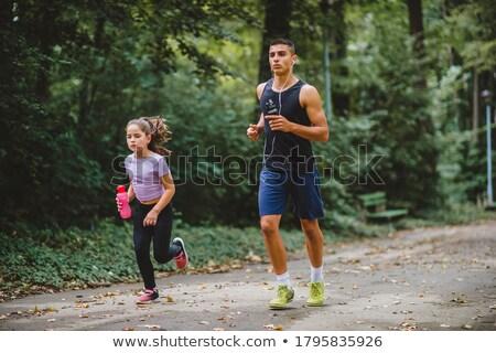 Jong meisje park lopen najaar stad vrouwen Stockfoto © cookelma