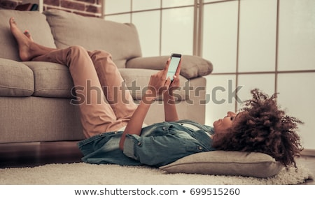 Stock photo: Woman Using Her Mobile Smart Phone at Home