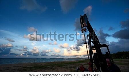 силуэта · нефть · области · закат · небе · Nice - Сток-фото © pixinoo