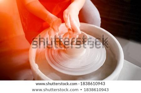 Female potter molding a bowl with hand tool Stock photo © wavebreak_media