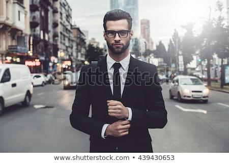 elegant young businessman in suit stock photo © neonshot