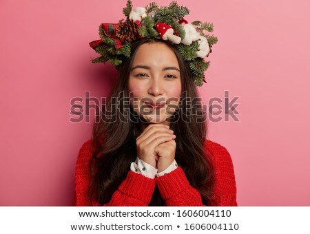 Headshot of lovely brunette woman keeps hand under chin, has combed hair, makeup, healthy skin, wear Stock photo © vkstudio