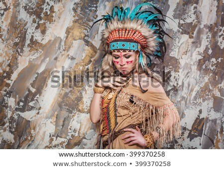 Stock photo: Young woman in costume of American Indian