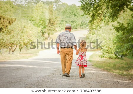 grandfather with the granddaughter in the park in autumn stock photo © paha_l