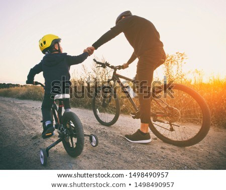 boy biking in field of flowers stock photo © is2
