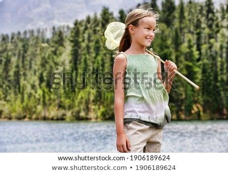 Drie outdoor kinderen stand samen meer Stockfoto © ElenaBatkova