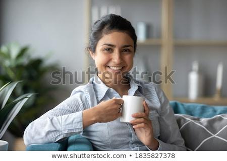 Optimista bastante joven taza té Foto stock © deandrobot