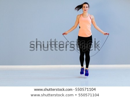 Woman with skipping rope in the gym Stock photo © photography33