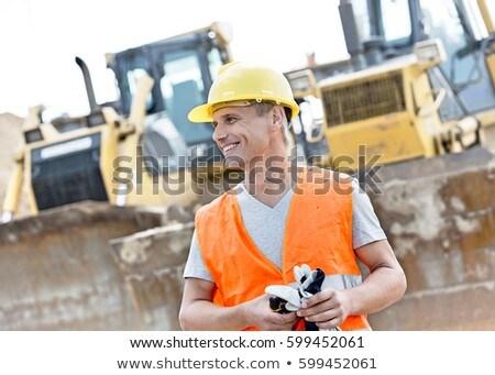 munkás · fiatal · építkezés · dolgozik · töprengő · néz - stock fotó © photography33