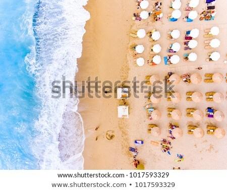 Grécia guarda-sol praia água sol mar Foto stock © jonnysek