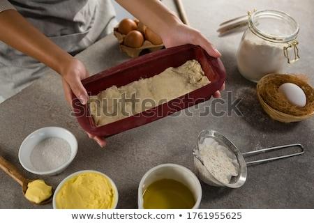Woman preparing dough surrounded with various ingredients Stock photo © wavebreak_media