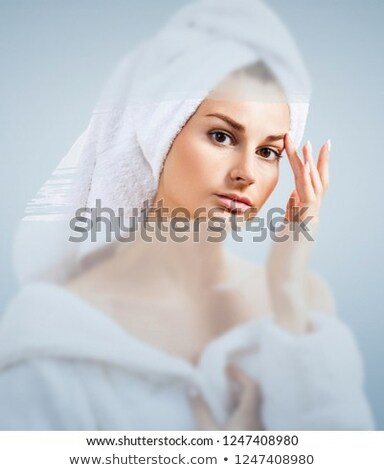 Beautiful woman in the shower behind glass with drops on the background of a window with a panoramic Stockfoto © galitskaya