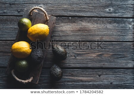 Avocado and knife on cutting board on old wooden table backgroun Stock photo © marylooo