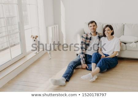 Nyugodt pár ül padló kanapé átölel Stock fotó © vkstudio