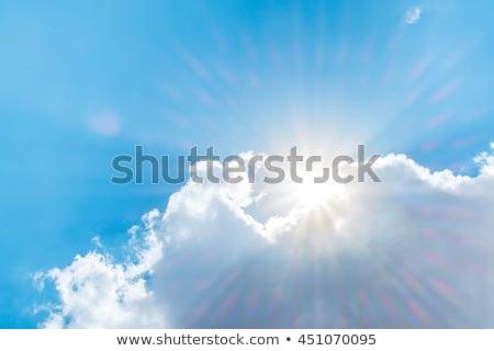 Słońce oświetlenie duży biały chmury nieba Zdjęcia stock © artjazz