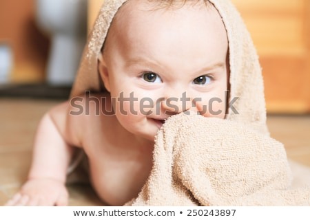 Small 8 months baby after bathing on the floor   Stock photo © Lopolo