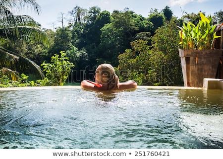 Kobieta tropikalnych basen patrząc dżungli lata Zdjęcia stock © Kzenon