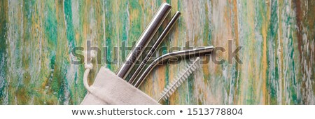 Steel drinking straws on painted wooden background. Zero waste concept BANNER, LONG FORMAT Stock photo © galitskaya