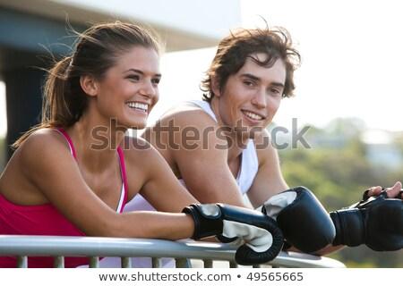 Luvas de boxe sorridente casal Foto stock © Jasminko