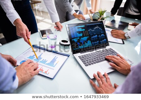 African Business Advisor Using Financial KPI Dashboard Stock photo © AndreyPopov