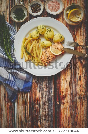 Fresh and tasty baked salmon served with young boiled potatoes and yellow bean. Stock photo © dash
