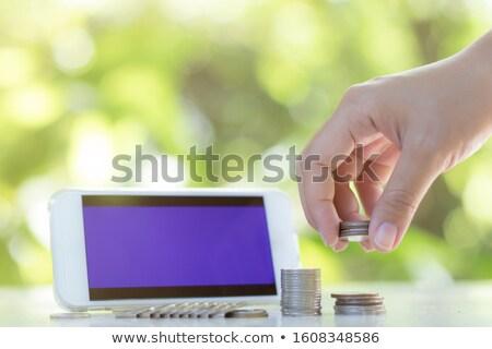 teléfono · móvil · moneda · mano · teléfono · celular - foto stock © your_lucky_photo