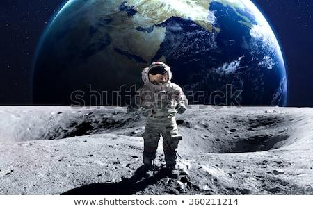 Astronauta księżyc powierzchnia podróży noc rock Zdjęcia stock © Harveysart
