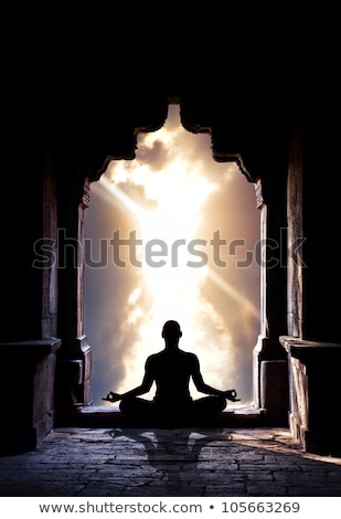 Stock photo: Male silhouette meditating with chakra