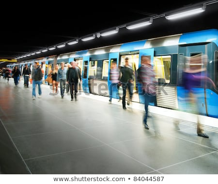passengers and moving train on metro station stock photo © paha_l
