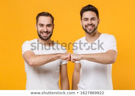 felnőtt · férfi · magasra · tart · kettő · mosolyog · férfi - stock fotó © lovleah
