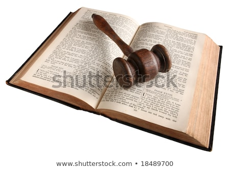 Stock photo: a wooden judges gavel on an 1882 bible