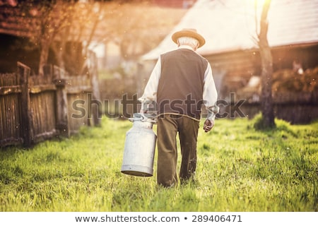 Farmer carrying milk Stock photo © photography33