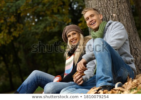 couple sitting in dead leaves Stock photo © photography33