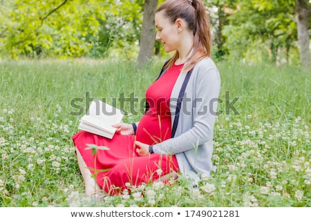 beautiful caucasian woman reading outdoor stock photo © aremafoto