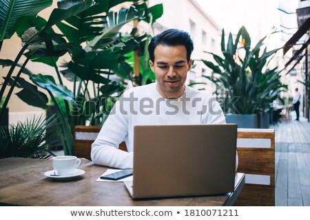 hispanic businessman   cafe laptop working stock photo © dgilder