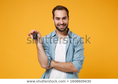 Human hands and key isolated on white background  stock photo © inxti
