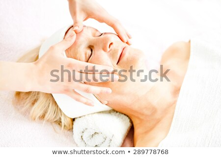 mature woman having facial massage stock photo © photography33
