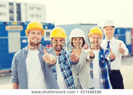 Thumbs up from a young construction worker Stock photo © photography33