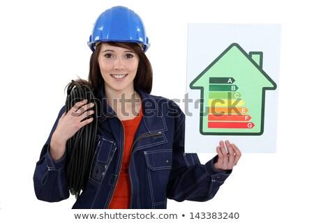 Női építőmunkás promótál energia megtakarított pénz nő Stock fotó © photography33