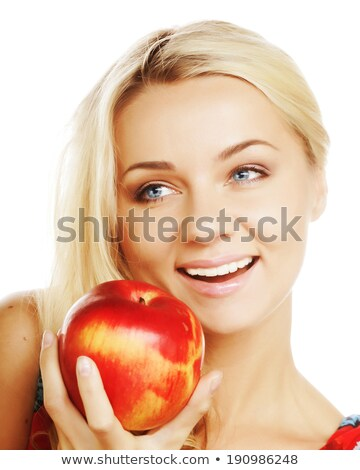 Stock photo: pretty brunette female smiling with apple