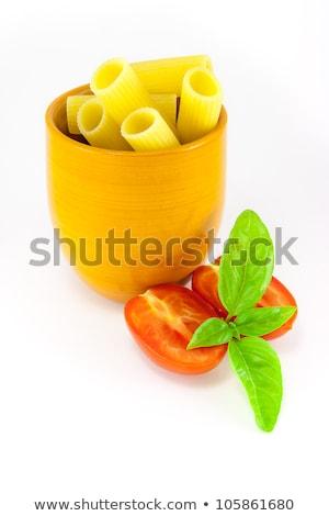 Rigatoni pasta in an orange jar with tomatoes and basil Stock photo © Armisael