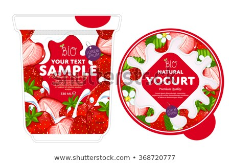 Stock fotó: Strawberry Falling Into A Container Of Milk