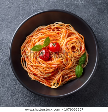 plate of pasta with tomato and basil Stock photo © M-studio