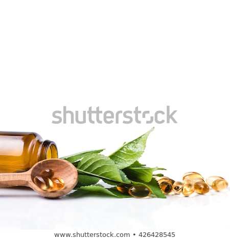 natural medical pills with green leaves stock photo © loopall