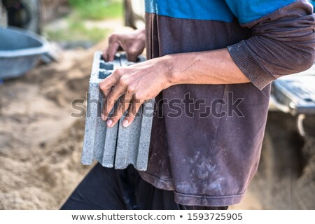 Worker carrying a concrete block Stock photo © photography33