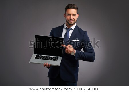 Man presenting laptop Stock photo © photography33