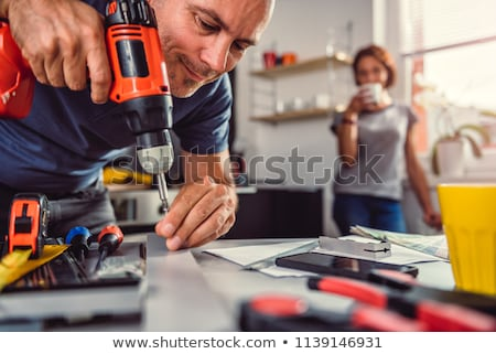 Woman with a cordless drill/screwdriver Stock photo © photography33
